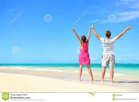 Happy Free Couple Cheering On Beach Travel Holiday Stock