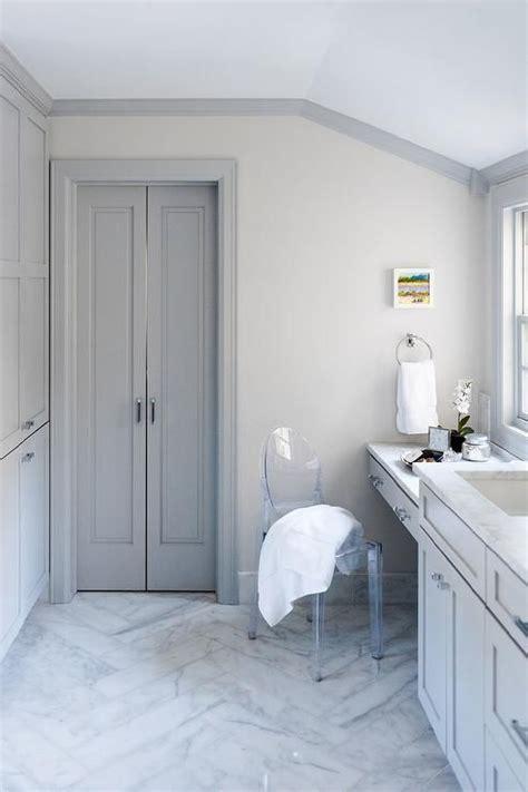 gray bifold master bathroom doors compliment gray crown