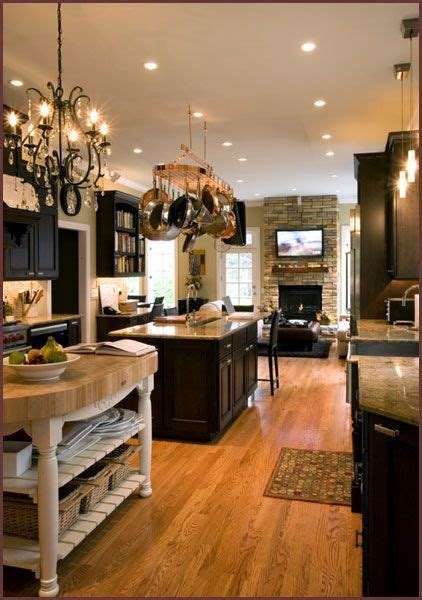 pictures of kitchens with painted cabinets espresso cabinets light floors butcher block island 9125