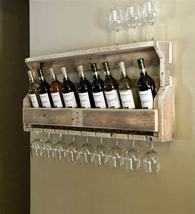 simple but cool wall mounted homemade wine rack made from With what kind of paint to use on kitchen cabinets for wine bottle hurricane candle holders