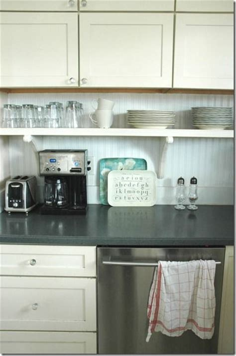 small shelf  cabinets  items  sit  counter