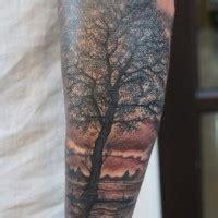 black ink moon  black forest tattoo  arm