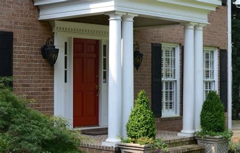 How Much To Build A Covered Porch by Extended Patio Brick House Covered How Much Does It Cost