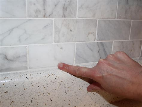 large bathroom wall cabinet how to install a marble tile backsplash hgtv