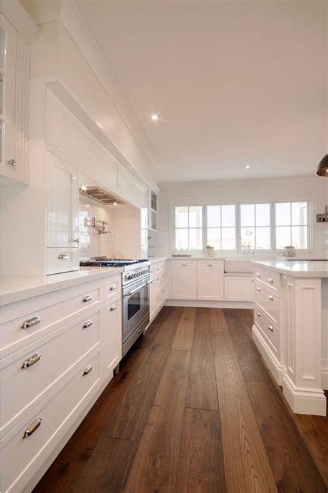 kitchens with hardwood floors and white cabinets 20 gorgeous examples of wood laminate flooring for your 770 | Clean white kitchen design with wood floor
