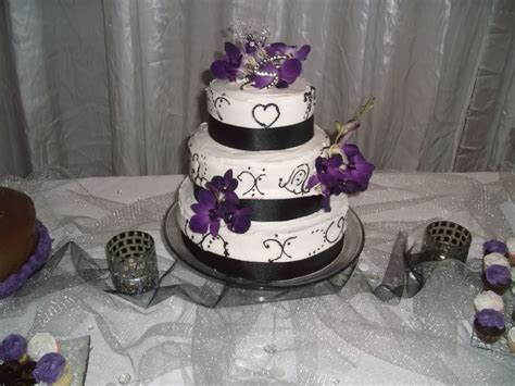 Black And White Wedding Cake With Purple Orchids