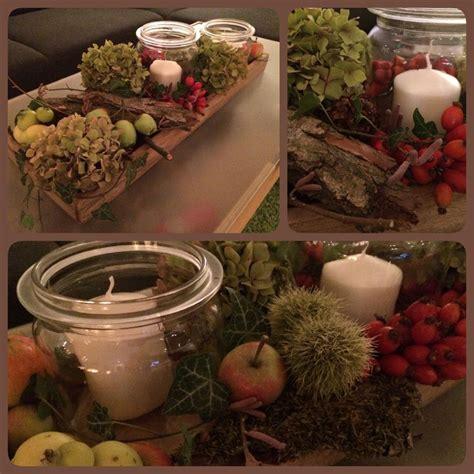 deko ideen kerzen im glas herbstdekoration herbst dekoration kerzen efeu hortensie hagebutte kastanie rinde glas 196 pfel