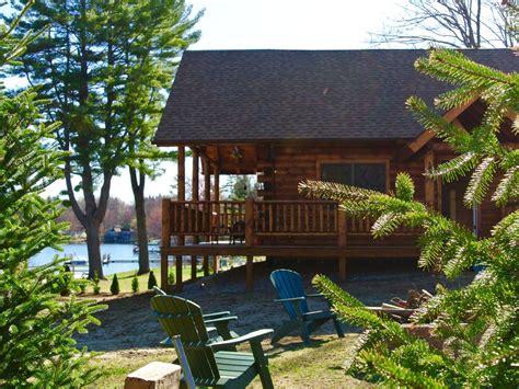 luxury log cabin lake winnisquam pvt beach boat slipoutdoor kitchen fire pits tilton