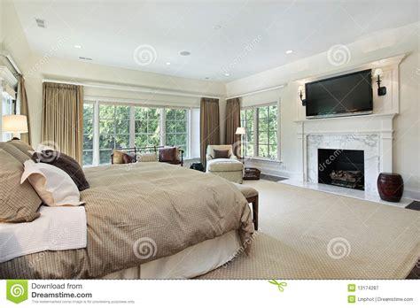 photographie à la chambre chambre à coucher principale avec la cheminée de marbre