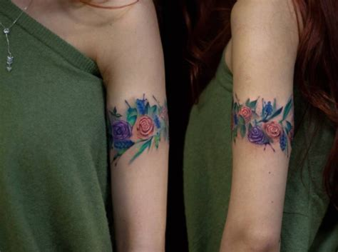 cool colored arm band shaped tattoo  flowers