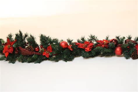 christmas garland hire artificial natural garland with red decorations