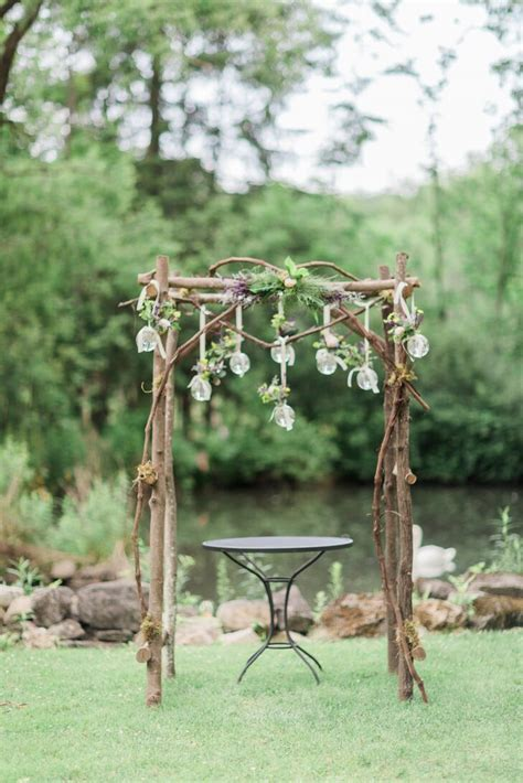 rustic wooden wedding arch  glass orbs
