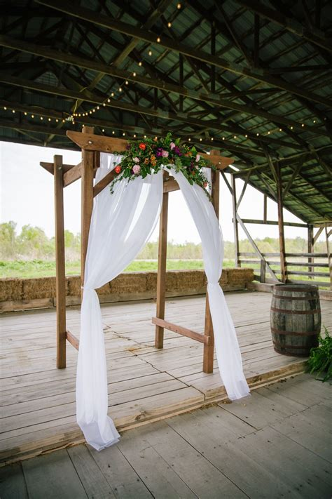 diy wooden wedding arch  colorful flowers