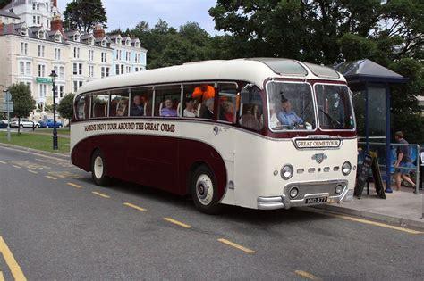 bus  stock photo people riding  historic bus