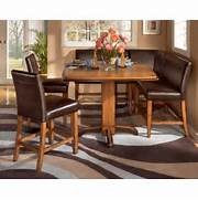 Dining Set Bench Style by Ashley FurnitureUrbandale 6 Piece Dining Set Pub Table With 5 Stools