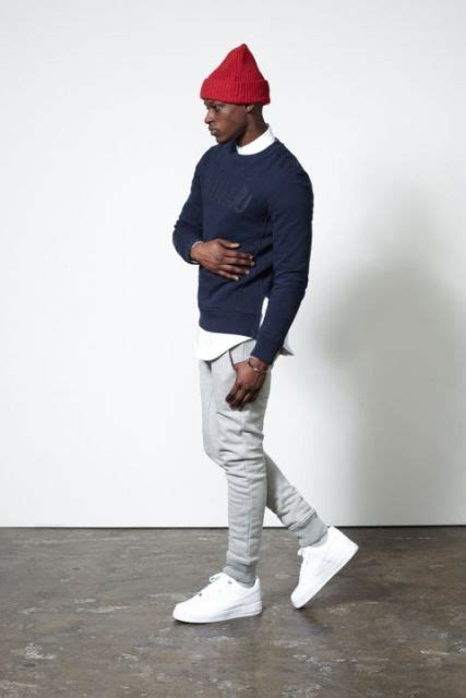 Picture Of With navy blue sweater gray pants and white sneakers