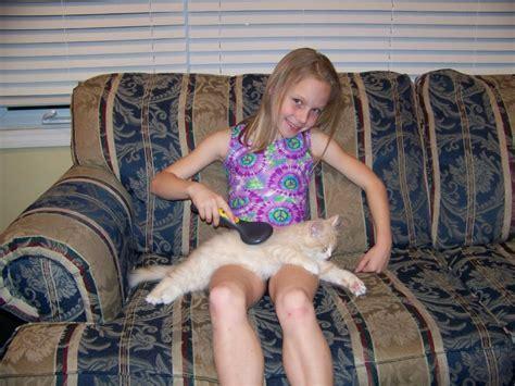 Little Girl Grooming Her Pu Y