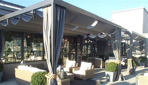 custom retractable pergola cover  awning works  patio lane