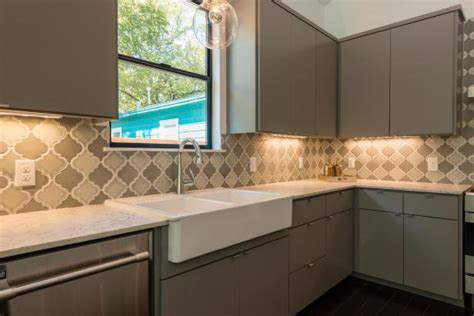 Quatrefoil Tile Backsplash  Savary Homes. Living Room Ottoman. Purple Front Door. Fox Marble. Wall Hung Toilet. Stainless Steel Bar Stools. Contemporary Lamp Shades. Broyhill Planter. Greco Construction