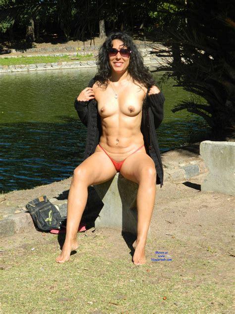 Nude Brunette In A Public City Park January