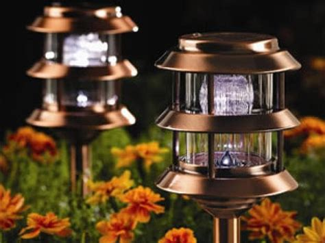 backyard solar lights how to illuminate your yard with landscape lighting hgtv