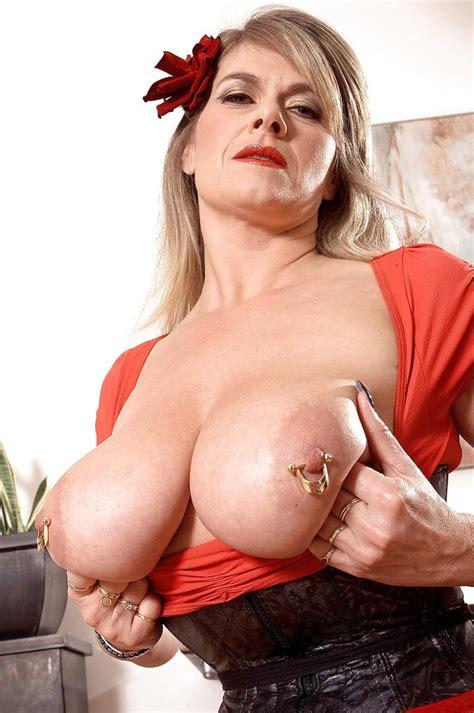 Mature Big Titted Marina Montana Displays Her 15 Piercings