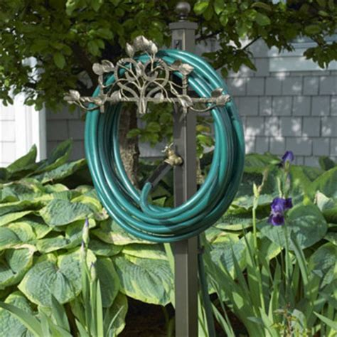 decorative garden hose holder with outdoor faucet extension
