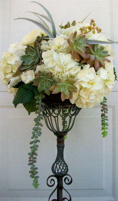 reception white hydrangea succulents tall arrangement