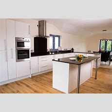 Laminate Flooring Kitchen Intended For White Cabinets