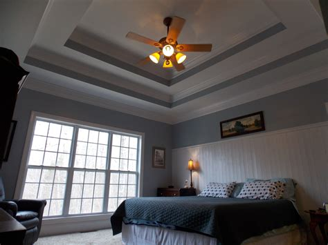 Double Tray Ceilings And Bead Board Wainscoting.