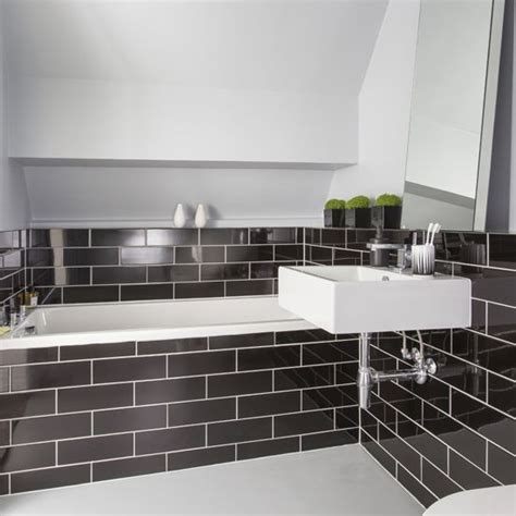 Black And White Tiled Bathrooms by 25 Best Ideas About Metro Tiles Bathroom On