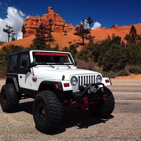 huge jeep wrangler jeep country in a lifted jeep wrangler with big tires and