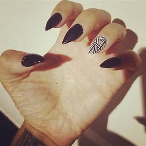 I am obsessed with my black and white stiletto nails ...
