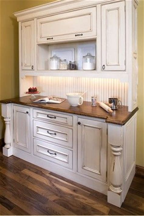 Bake Center With Distressed White Enamel Cabinets And