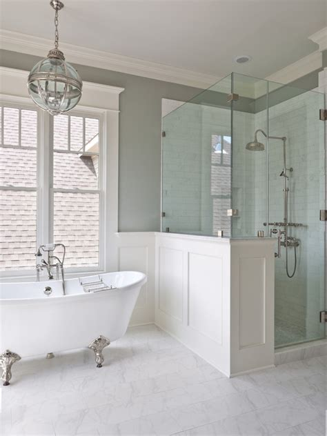half wall glass shower master bath claw foot tub centered under the window half wall glass shower enclosure to the