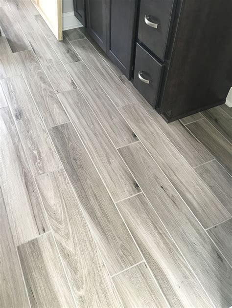plank tile flooring newly installed gray weathered wood plank tile flooring mudroom foyer ideas bathroom ideas