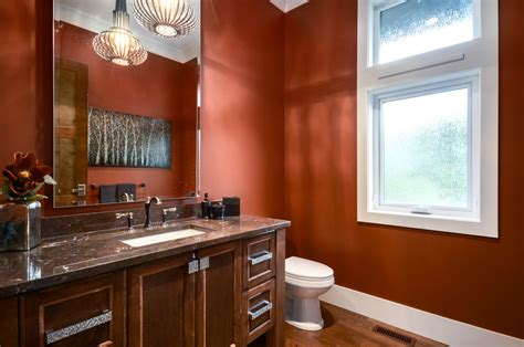 burnt orange paint color powder room transitional with brown countertop wood