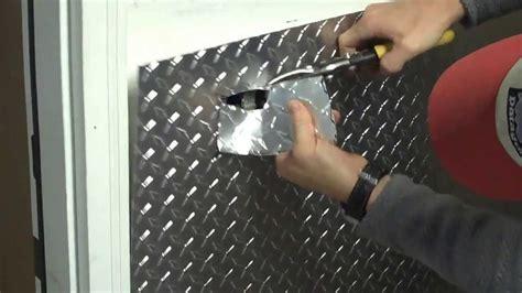 part  installing aluminum diamond plate wall panels