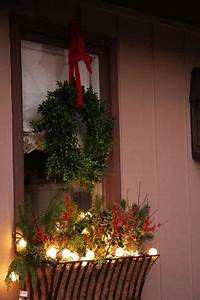 Christmas window boxes with magnolia berries and greens