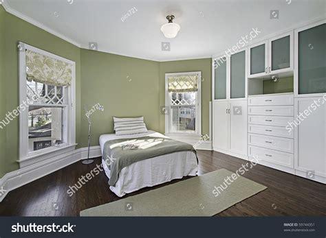 master bedroom green walls dark wood stock photo