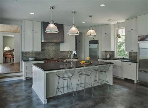 gray industrial kitchen features light gray cabinets