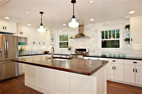 white kitchen  wood island carrara backsplash black granite