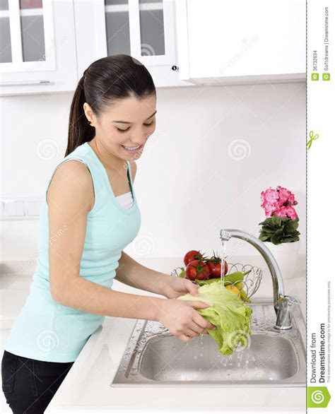waters in the green kitchen beautiful washing vegetables stock photo image 9011