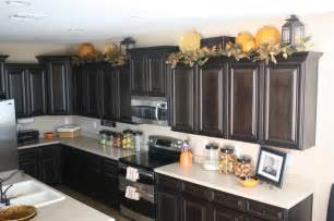top kitchen cabinet decorating ideas lanterns on top of kitchen cabinets decor ideas jars pumpkins and
