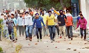 One killed and a dozen injured as Sikh protesters clash ...