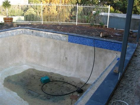 pool refurbishment new stone coping tiles and waterline