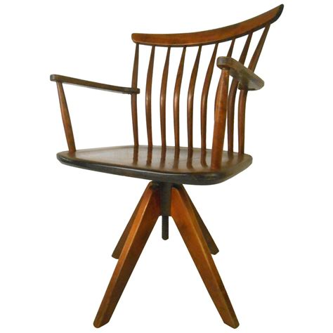 mid century modern wooden desk swivel chair with four legs