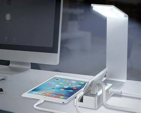 desk l with charging station the aluminum led desk l boasts integrated charging