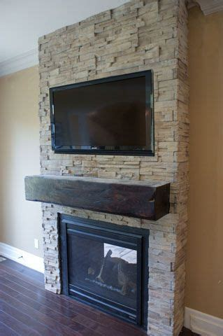 stone fireplace chunky wood mantel tv mount