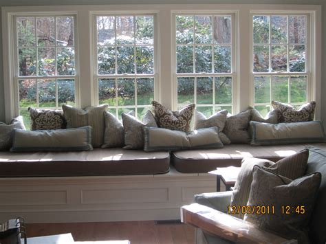 large bay window seat  misc pillows  cushions